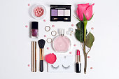 Still life of fashion woman. Set of decorative cosmetic make up with perfume and rose . Top view
