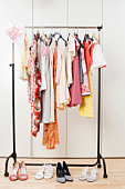 still life of female clothes hanging on wardrobe