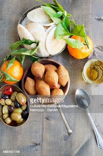 Still life of flatbreads with fruit and olives : Stock Photo