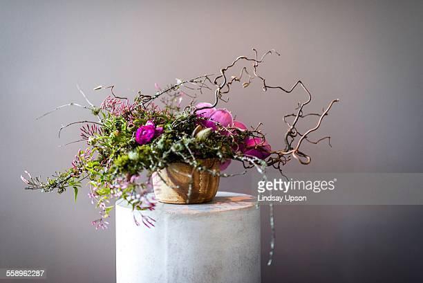 Still life of flower arrangement on plinth