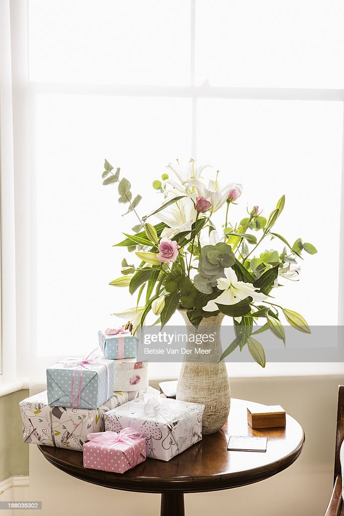 Still life of flowers and weddingpresents. : Stock Photo