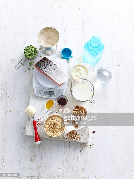 Still life of food measuring choices with kitchen scales