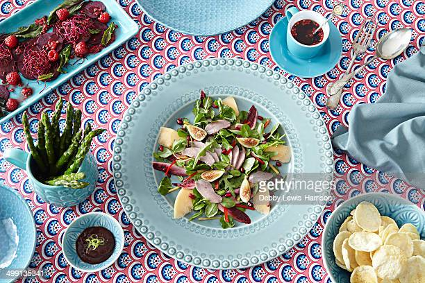 Still life of foods on matching crockery