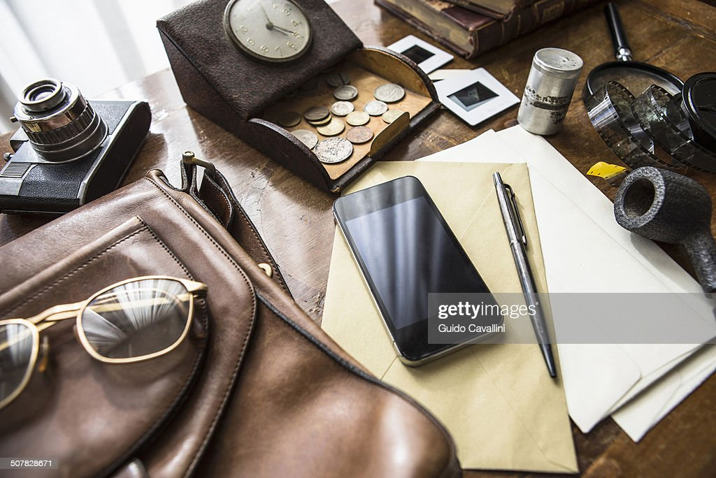 Still life of group of vintage objects with smartphone