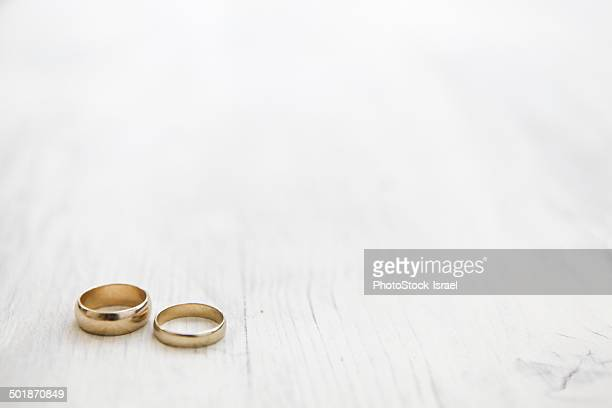 Still life of his and hers wedding rings