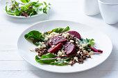 Still life of lentil, beetroot and feta salad