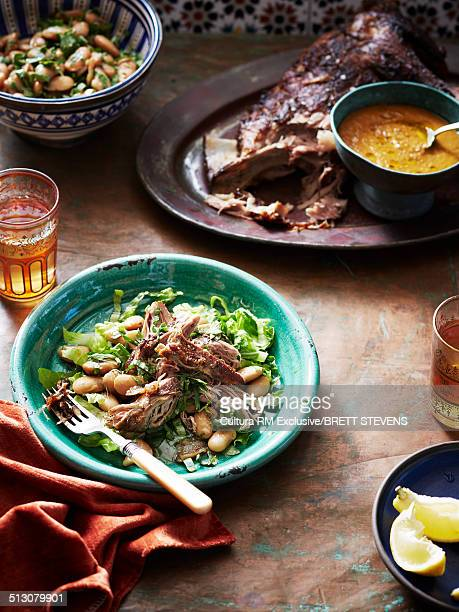 Still life of middle eastern pulled lamb with salad