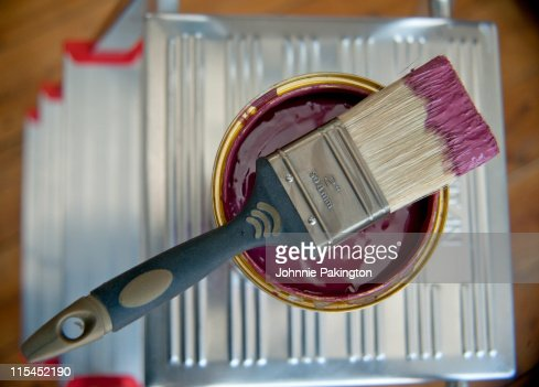 Still life of paint brush dipped in paint : Stock Photo