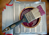 Still life of paint brush dipped in paint