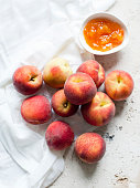 Still life of peaches and a bowl of peach jam