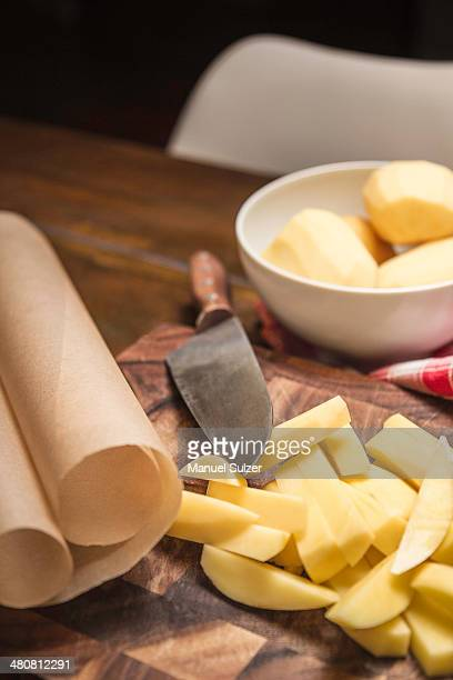 Still life of peeled and sliced potatoes and kitchen knife