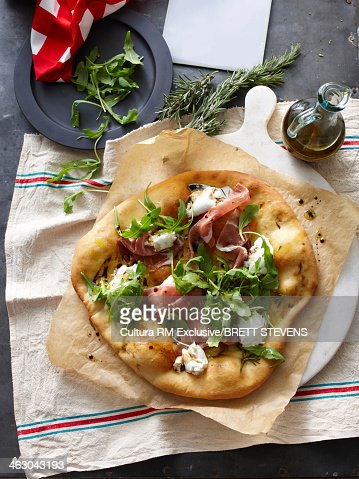 Still life of pizza bianco with herbs and olive oil