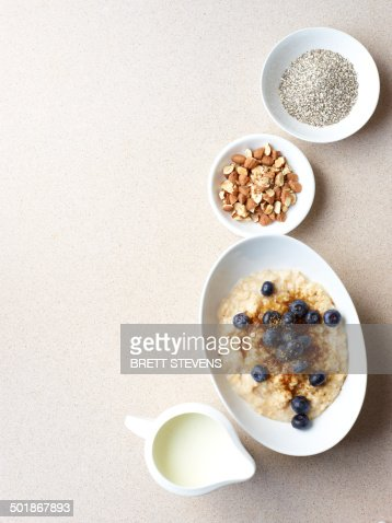 Still life of porridge with fruit and nuts : Stock Photo