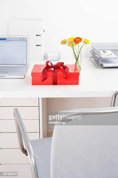 still life of present on office desk