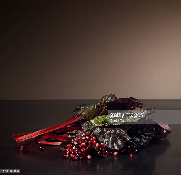 Still life of rhubarb and pomegranate seeds