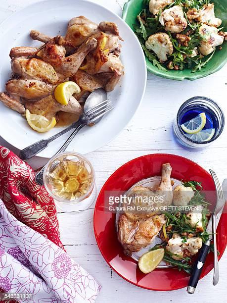 Still life of roast lemon spatchcock