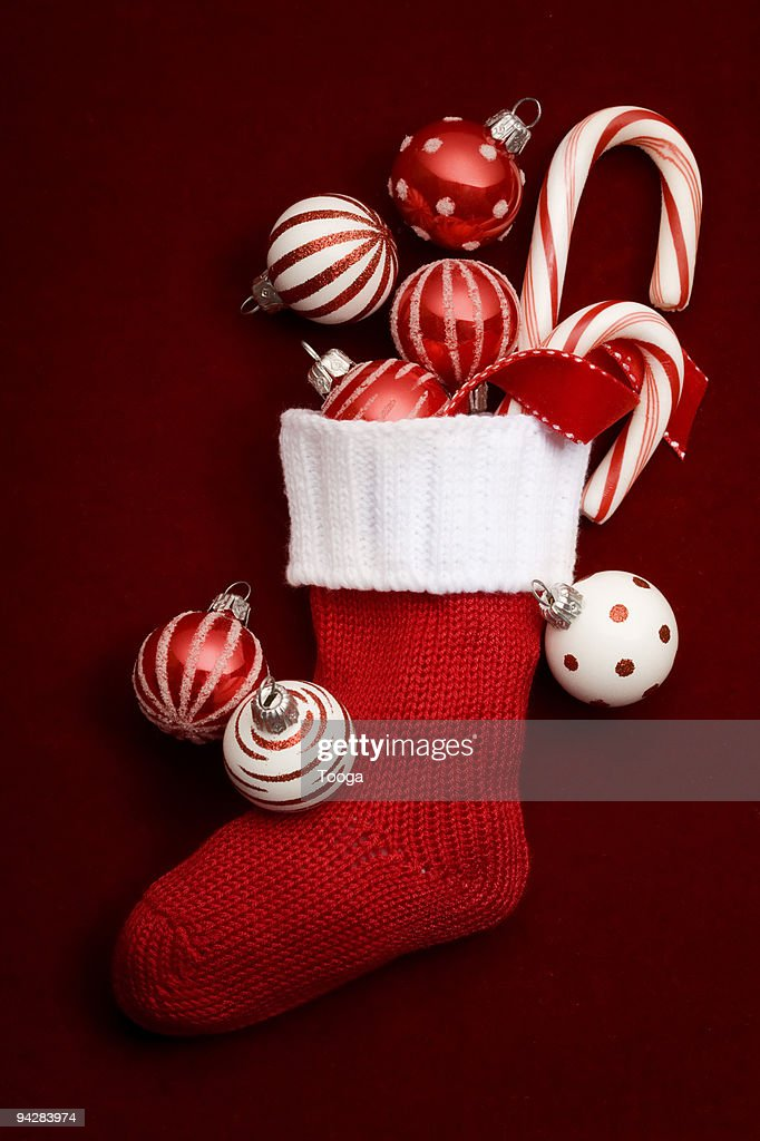 Still life of stocking with red ornaments : Stock Photo