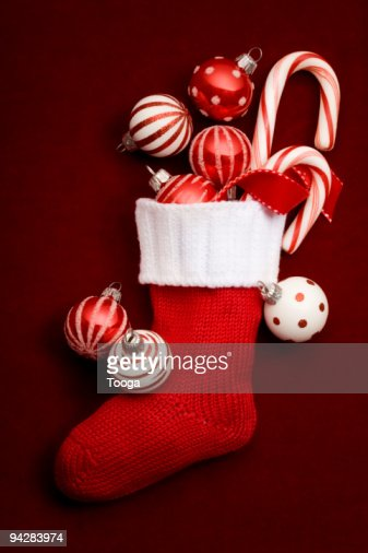 Still life of stocking with red ornaments