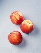 Still life of three peaches