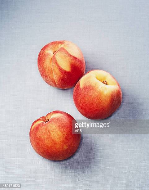Still life of three peaches