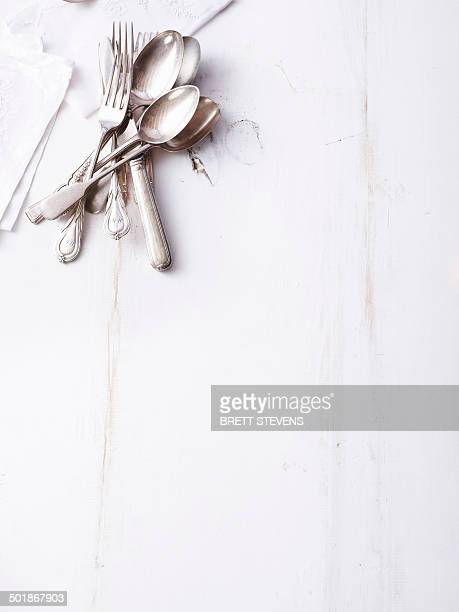 Still life of traditional cutlery on empty table