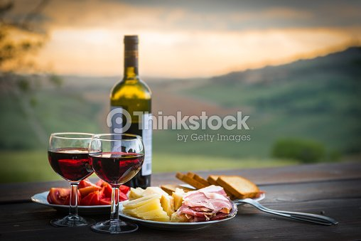 Still life Red wine ,cheese and prosciutto