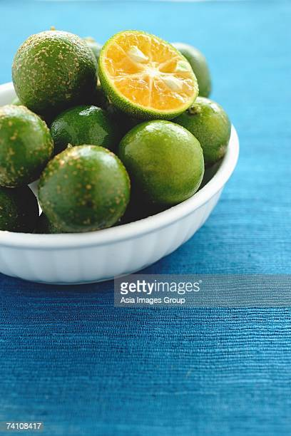 Still life with bowl of limes