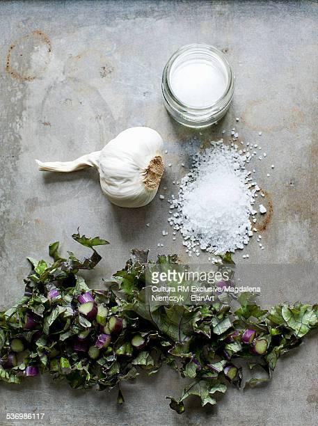 Still life with chopped leaf, garlic and sea salt