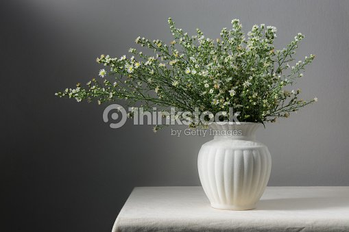 Still Life With Flowers In White Vase On Table Stock Photo Thinkstock
