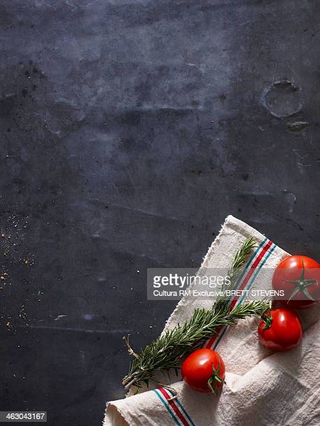 Still life with fresh tomatoes and rosemary
