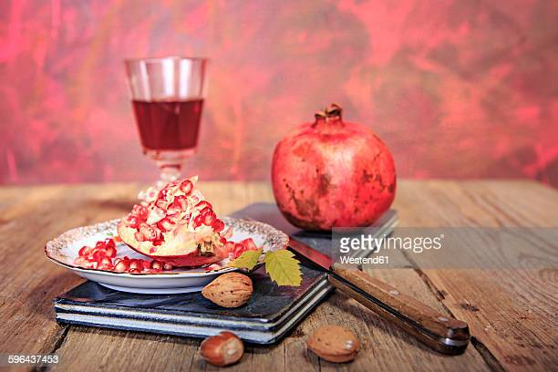 still life with juice, pomegranate and nuts