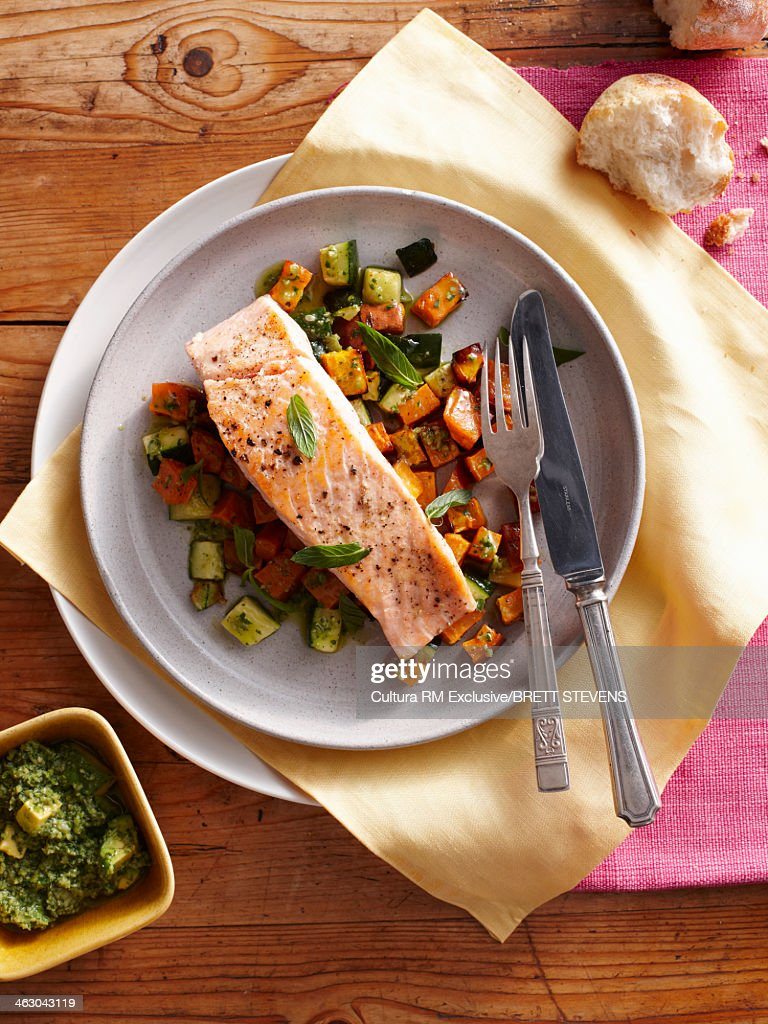 Still life with pan fried salmon and sweet potatoes : Stock Photo
