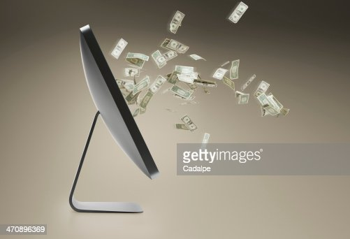 Still life with personal computer and floating dollar bills : Stock Photo