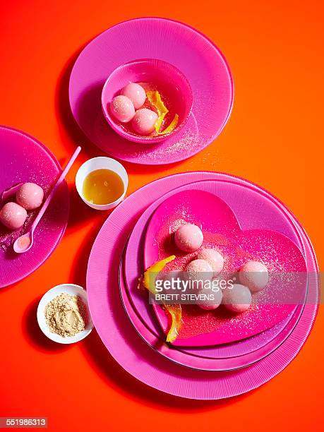 Still life with pink plates and sticky rice dumplings