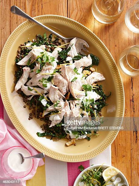 Still life with poached chicken and lentil salad