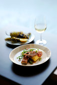 Still life with prawn, potato and micro greens
