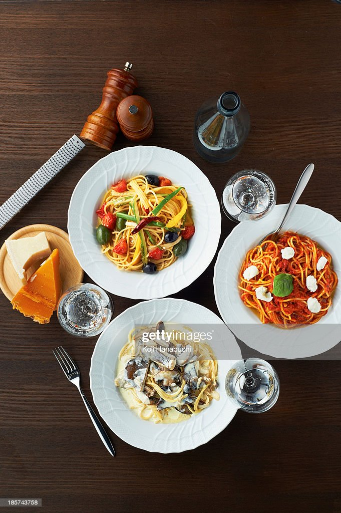 Still life with selection of spaghetti dishes : Stock Photo