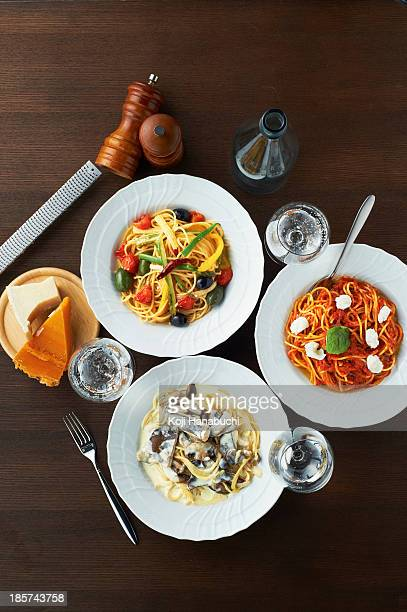 Still life with selection of spaghetti dishes