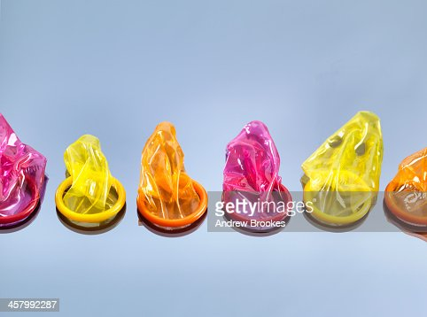 Still life with six colorful condoms, illustrating the decision to take precautions during sex