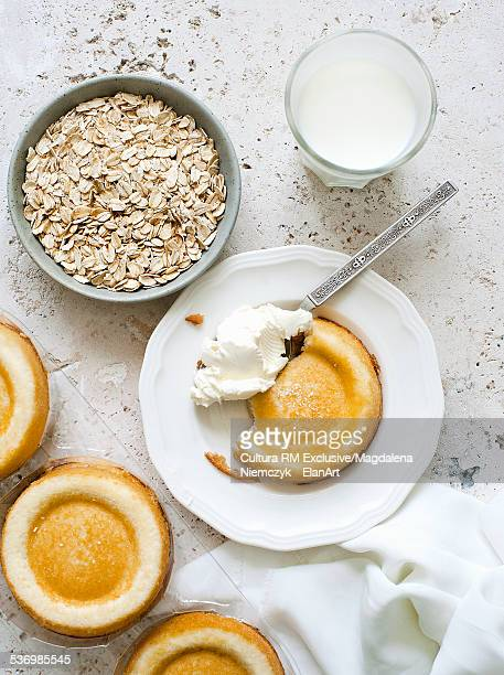 Still life with sponges, oats and whipped cream