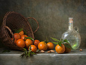 Still life with tangerines and antique bottle