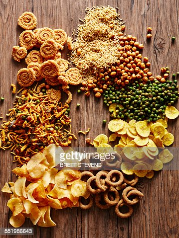 Still life with variety of Indian curried snacks : Stock Photo