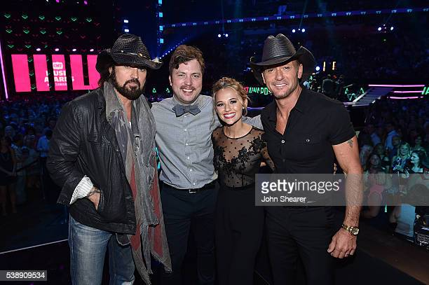 'Still the King's' Billy Ray Cyrus Travis Nicholson and Madison Iseman join Tim McGraw during the 2016 CMT Music awards at the Bridgestone Arena on...