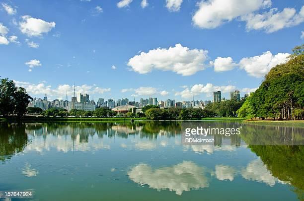 Still waters of pond reflecting Sao Paulo, Brazil's skyline