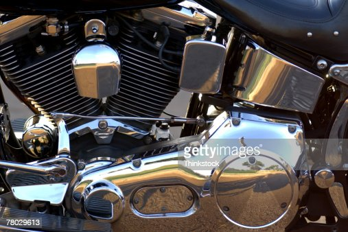 Still-life close-up of a chrome covered engine on the side of a motorcycle
