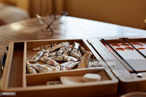 Still-life of aquarelle paint tubes in wooden case