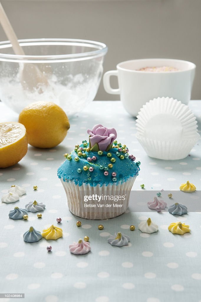 stilllife of cake baking with finished cupcake. : Stock Photo