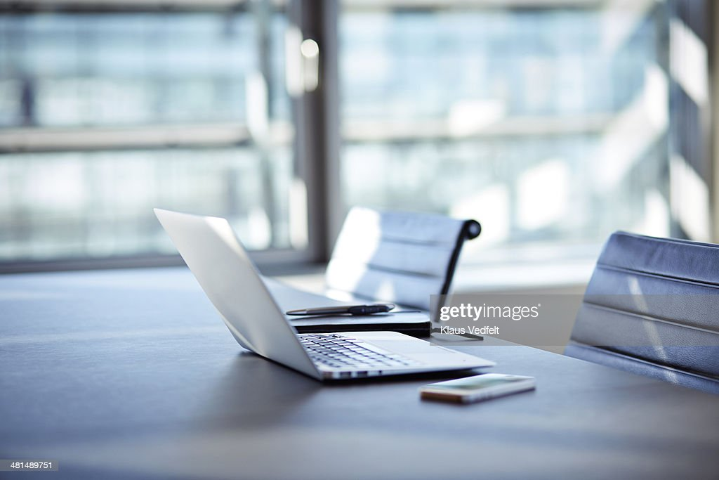 Still-life of laptop, phone and notebook with pen : Stock Photo