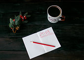 Still-life with a notebook with a red inscription 2018, a Cup of coffee and fir-tree branch with red berries