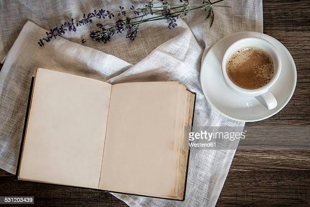 Stilllife with old book, cup of coffee, lavender and cloth